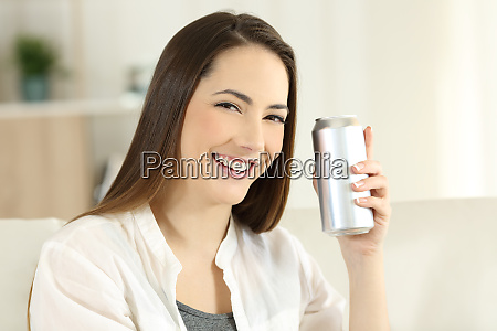 woman showing a refreshment can at