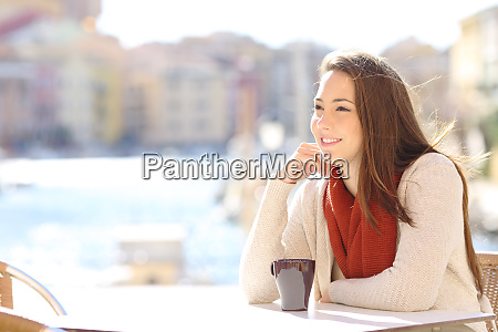 woman relaxing in a coffee shop