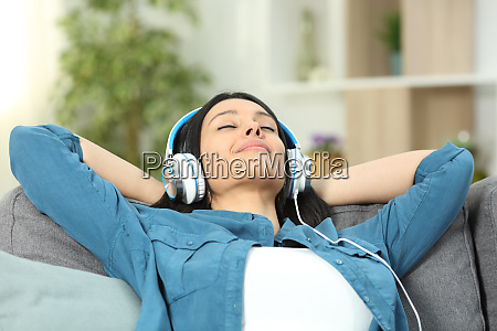 relaxed woman resting listening to music