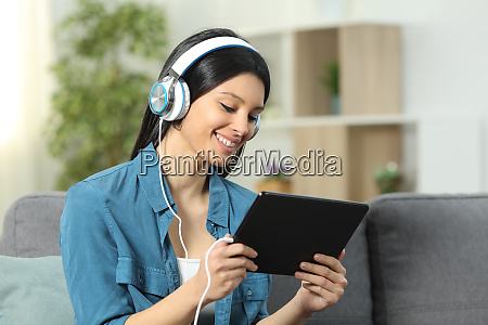 happy woman watching and listening videos