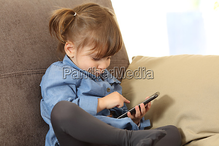 baby playing with a smart phone