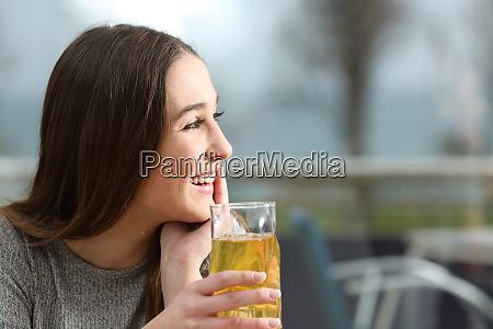 happy coffee shop customer looking at