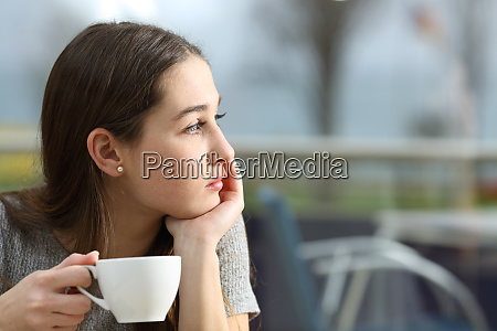 pensive woman looking away in a