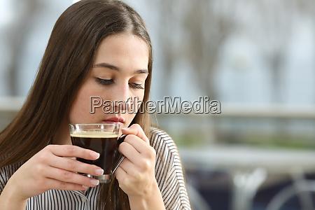 sad woman thinking in a coffee