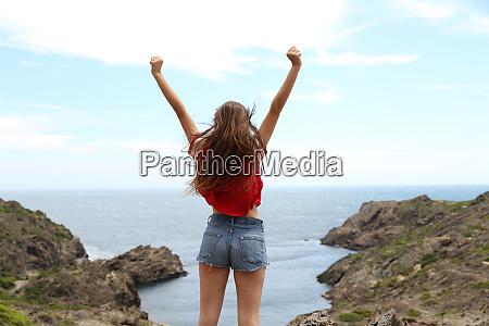 back view of a joyful teen