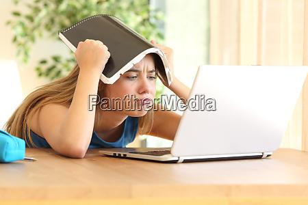 bored student doing homework