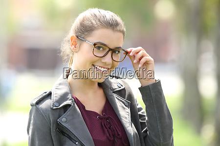 fashion girl wearing eyeglasses looking at
