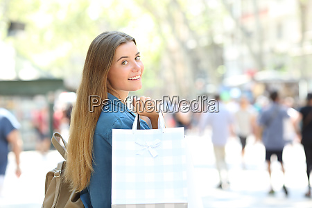 beauty shopper showing shopping bags in