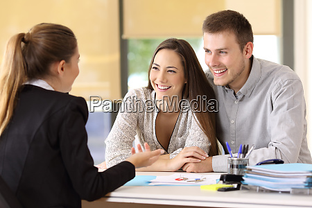 couple talking with a real estate
