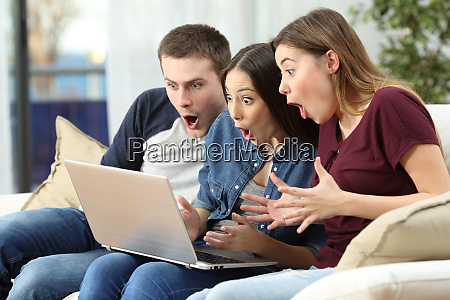 amazed friends watching content on line