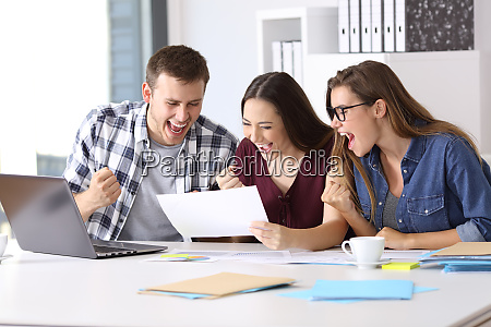 excited workers reading a good results