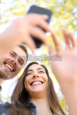 happy couple using smart phone together