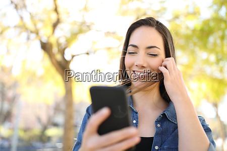 happy woman using smart phone touching