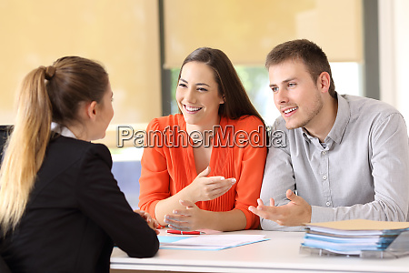 happy customers talking with office worker