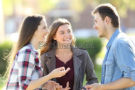 three friends having a conversation in