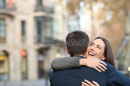 couple cuddling after marriage proposal
