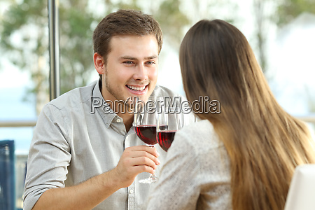couple dating drinking wine in a