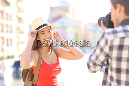tourist photographing his friend on vacations