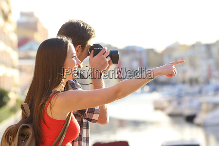 tourists sightseeing and taking photos outdoors