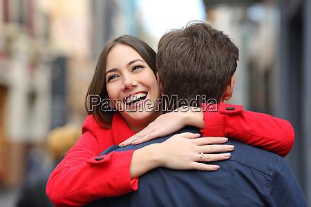 happy girlfriend hugging her boyfriend after