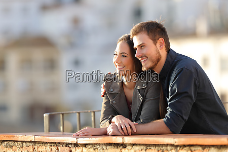 happy couple contemplating views from a