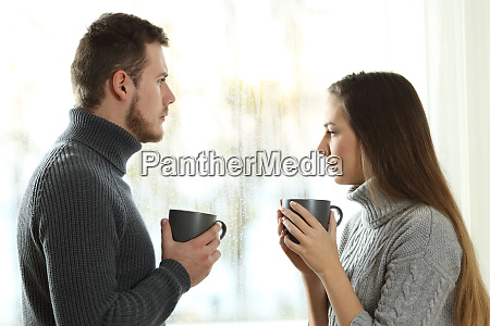 angry couple looking away after argument