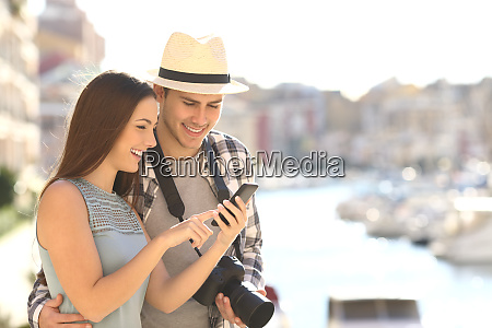 tourists booking hotel online on vacation