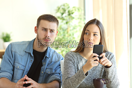 jealous boyfriend spying his girlfriend