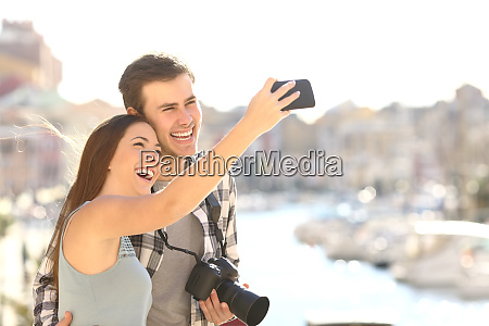 couple taking selfies on summer vacation
