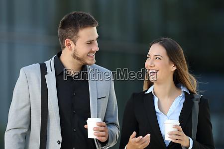 couple of executives walking and conversing