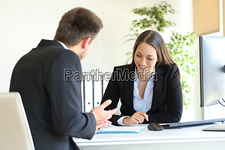 salesman selling to a client at