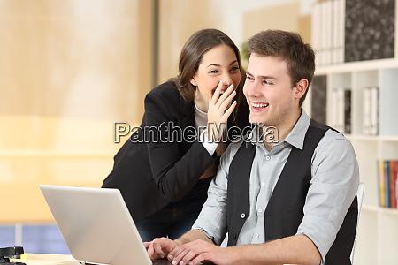 gossip businesspeople telling secrets