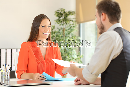woman giving resume in a job
