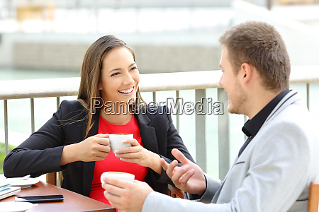 two executives talking during a coffee