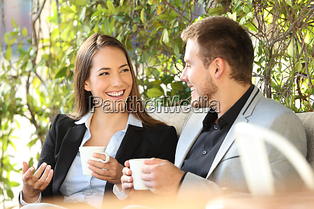 two executives talking in a coffee