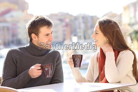 couple talking in a coffee shop