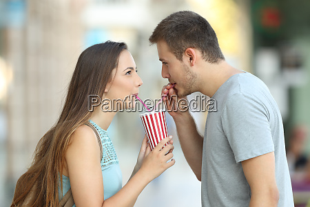 couple sharing a takeaway refreshment