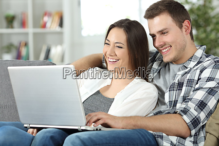 couple checking online content in a