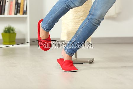 woman stumbling with an electrical cord