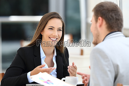 two, executives, having, a, business, conversation - 26580020