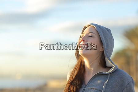 teenager girl breathing deep fresh air