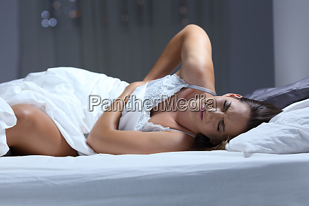 woman suffering back ache on a