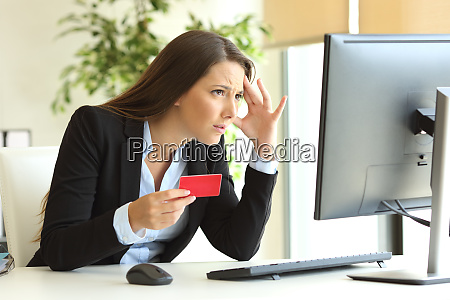 worried businesswoman buying with credit card