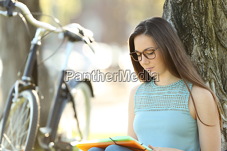 student studying wearing eyeglasses
