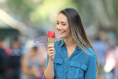happy woman holding an ice cream