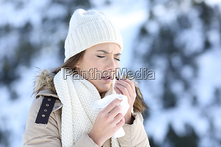 woman taking a pill in a