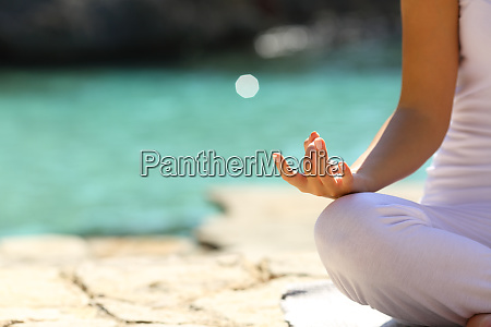 woman practicing yoga exercises on the