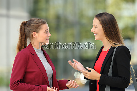 two executives talking on the street