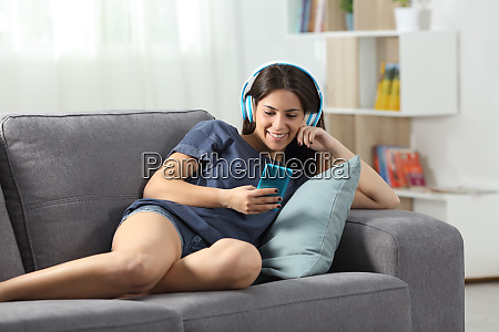 happy teen listening to music with