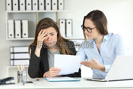 boss scolding an intern at office